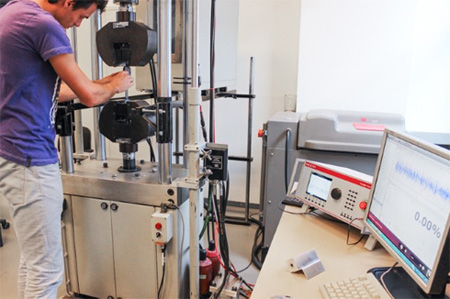 Single-Axis Test Rig featuring Moog Test Controller, performing carbon fiber material tests